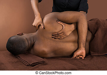 African Man Getting Spa Treatment