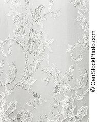 The beautiful embroidered ornament on a wedding dress