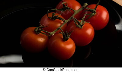 Ripe tomatoes lying on the plate - Tasty food. Brunch of red...