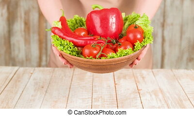 All colors of the garden on table. - Fresh salad. Female is...