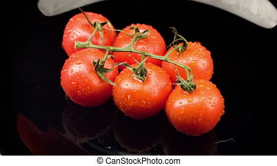 Red tomatoes lying on the plate - Natural food Ripe big...