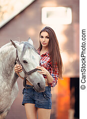 Woman and Horse. Casual Sexy Style - Portrait of young...