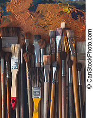 Series of wooden different size paintbrushes lying on...