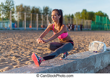 Fitness model athlete girl warm up stretching her...