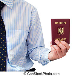 The passport for travel abroad of the Ukrainian citizen  in a man\'s hand