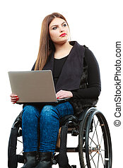 Woman invalid girl on wheelchair using computer - Real...