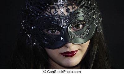 Beautiful girl in a mask with red lips