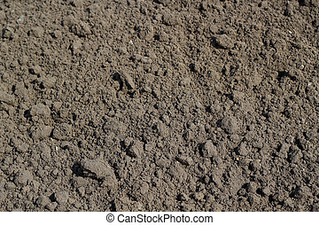 Tilled Earth Background - Tilled brown ground background at...