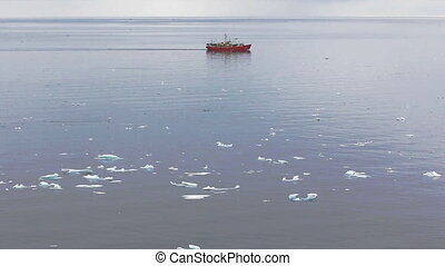 real Arctic. Drifting ice, research ship, flying in large...