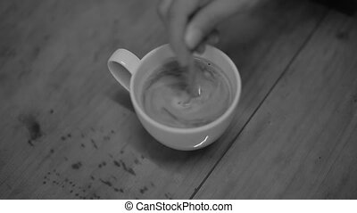 stirring coffee black and white tone color