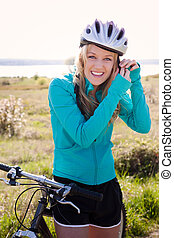 Sport woman - A sporty woman riding a bicycle outdoor