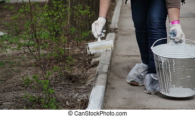 Cleaning in the city park. Series. - A woman has been...