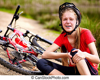 Bikes cycling girl wearing helmet. Girl girl fell off bike....