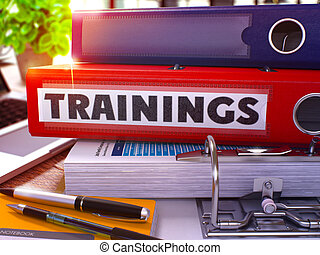 Trainings on Red Office Folder. Toned Image. - Trainings -...