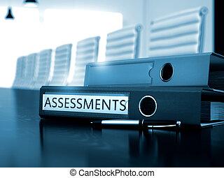 Assessments on Office Binder. Blurred Image. - Assessments....