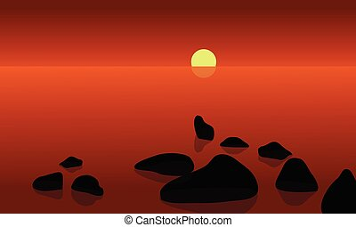 At sunrrise in beach scenery with rock and sun