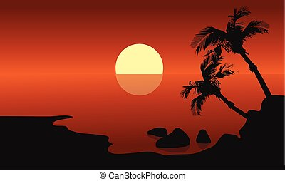 Scenery beach at sunset with sun and palm silhouette