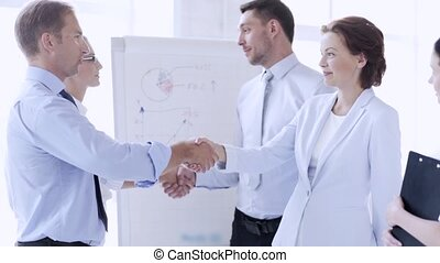 business people shaking their hands - business handshake -...