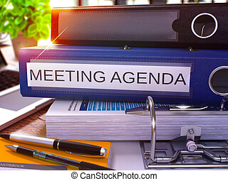 Meeting Agenda on Blue Ring Binder. Blurred, Toned Image.