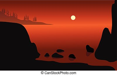 Beautiful rock in beach silhouette with orange backgrounds