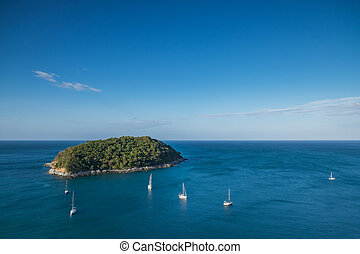 Tropical island - Aerial view of tropical island on sea with...