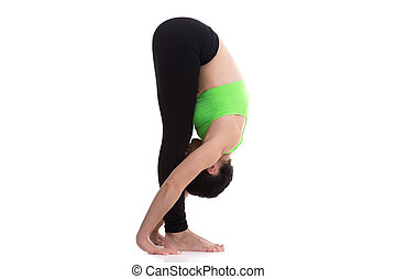 Uttanasana, intense stretch yoga pose - Sporty girl on white...