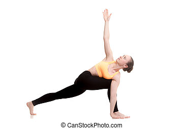Revolved Side Angle yoga Pose - Beautiful sporty girl in...