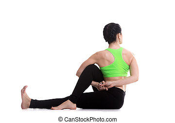 Deepened variation of Half lord of the fishes yoga pose -...
