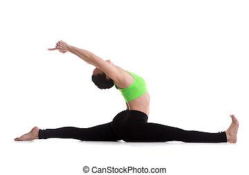 Sitting in splits yoga exercise - Fitness girl on white...