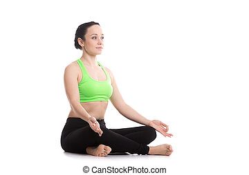 Sukhasana yoga pose - Serene girl practicing yoga, Sitting...