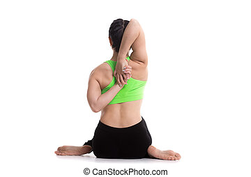 Cow face yoga asana - Sporty girl doing yoga training,...