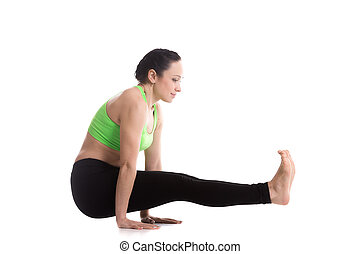 Celibatersquo;s yoga Pose - Beautiful sporty girl doing arm...