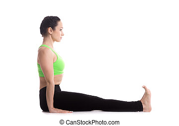 Staff yoga Pose - Sporty girl on white background sitting in...