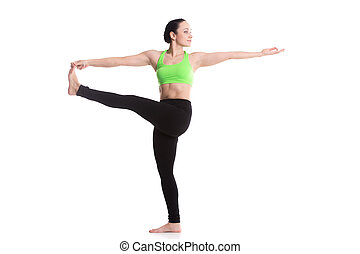 Stretched hand grasps big toe yoga asana - Serene sporty...