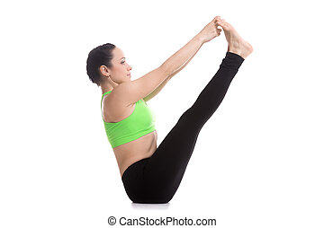 Both big toe yoga pose - Beautiful serene girl sitting in...