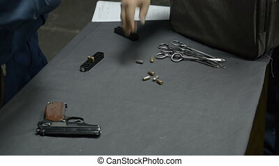Pistol and bullets on the table indoor