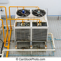 Industrial cooling towers on rooftop - Industrial cooling...