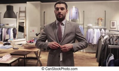 man taking selfie by smartphone at clothing store - sale,...