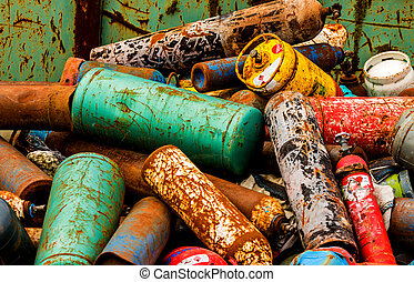 gas cylinders in a junkyard - gas bottles waiting in a...