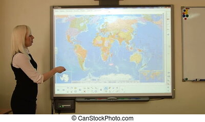 Geography teacher using interactive whiteboard