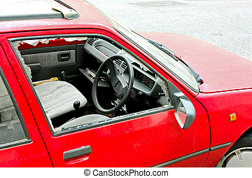 Burglary - Robbed car parked on a street with smashed window...