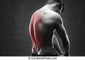 Man with backache Pain in the human body Muscular male body...