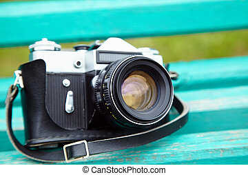 Old retro camera on vintage wooden boards film camera
