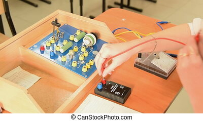 Making electric circuit on school physics equipment -...