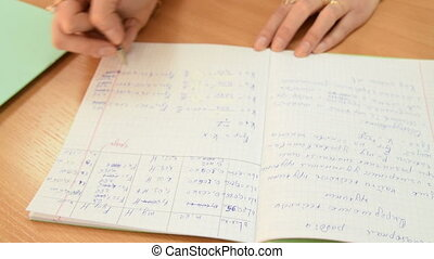 Teacher of physics checking test works - Close-up shot of a...