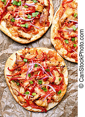 Homemade naan pizza, top view - Homemade naan pizza with red...