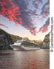 Geiranger fjord with cruise against sunset in Norway