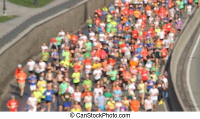 City marathon blurred runners of people