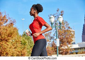 Runner girl running listening music earphones - Runner girl...