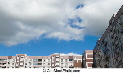 Clouds Moving over the Multistorey Buildings Time Lapse Yard...